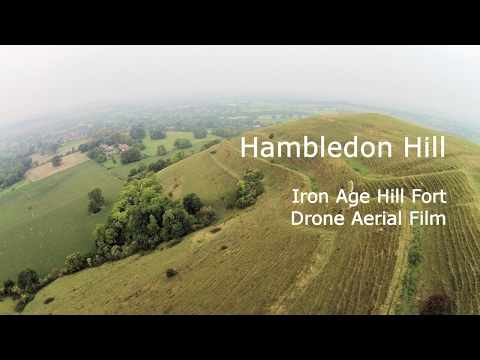 Hambledon hill drone aerial photography of this national trust iron age hill fort in dorset, england