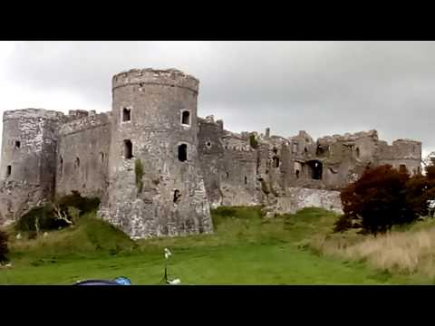 Carew castle viewed from a camp site - pembrokeshire, wales
