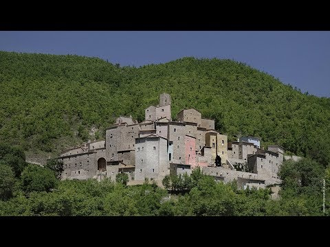 Postignano, the reconstruction of a medieval hamlet and castle in umbria, italy