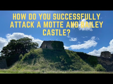 How do you successfully attack a motte and bailey castle?