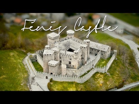 Travel italy: fénis castle (fenis) aosta valley. 4k drone aerial video