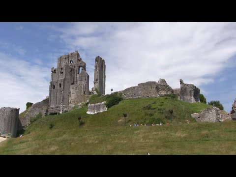 Corfe castle and village on the isle of purbeck in dorset.